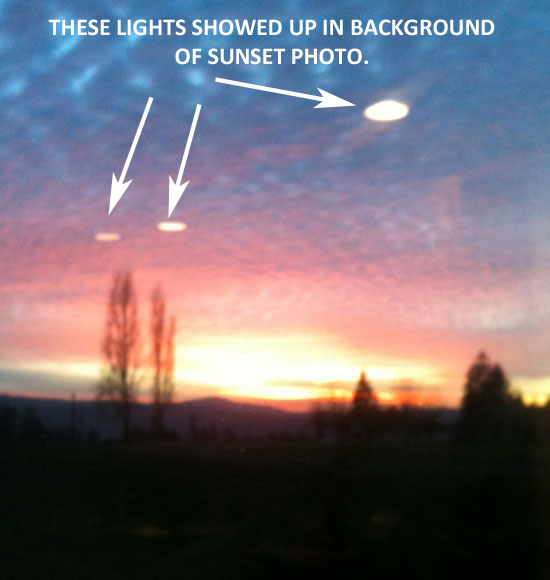 THESE BRIGHT CIRCULAR LIGHTS SHOWED IN BACKGROUND OF SUNSET PHOTO.