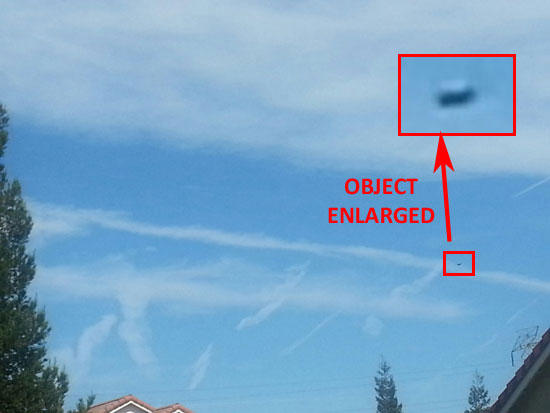 PHOTO OF OBJECT & ENLARGEMENT. SEVERAL CONTRAILS ARE IN THE PHOTO.