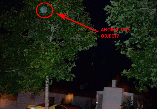 ANOMALOUS SPOT IS PROBABLY A DUST PARTICLE ILLUMINATED BY CAMERA FLASH.