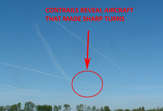 PHOTO OF CONTRAILS ON SAME DAY INDICATE ERRATIC AIRCRAFT MOVEMENTS.