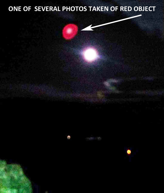 "1 OF SEVERAL PHOTOS TAKEN OF RED OBJECT. OBJECT COULD BE ""LENS FLARE."""