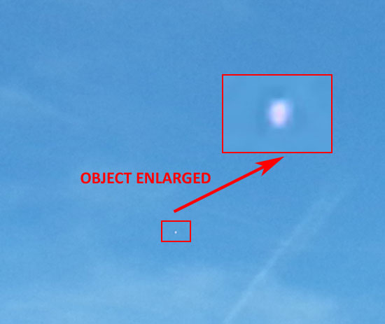 PHOTO & ENLARGEMENT OF SILVER/BRIGHT OBJECT.