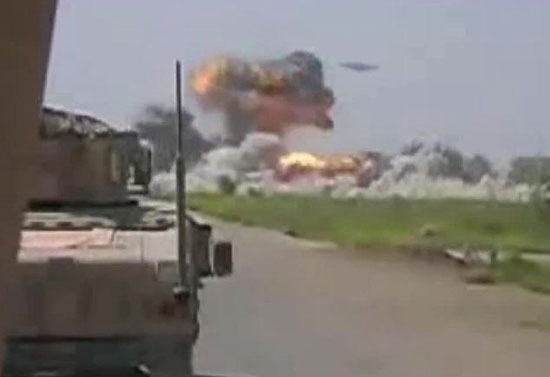 The cosmic coalition: Huge explosions are seen as an unidentified aircraft bombards a Taliban base in Afghanistan, in this screengrab from a video shot by U.S. Marines fighting in the war-torn country.