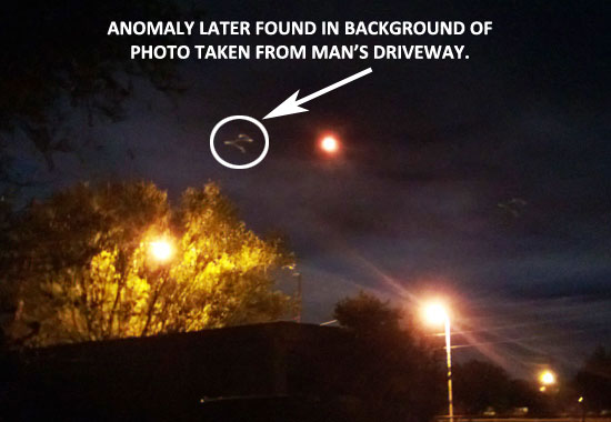ANOMALY FOUND IN BACKGROUND OF PHOTO TAKEN FROM DRIVEWAY.