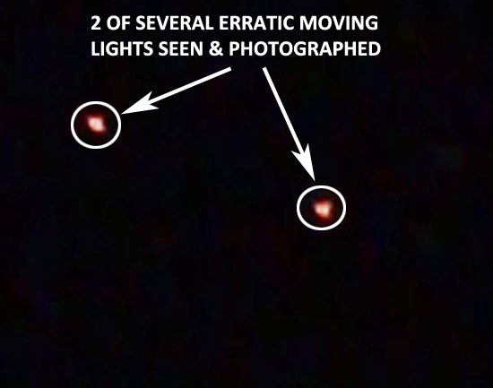 PHOTO A FEW OF THE LIGHTS SEEN MOVING ERRATICALLY IN NIGHT SKY.