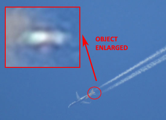 PHOTO & ENLARGEMENT OF UFO NEAR AIRCRAFT.