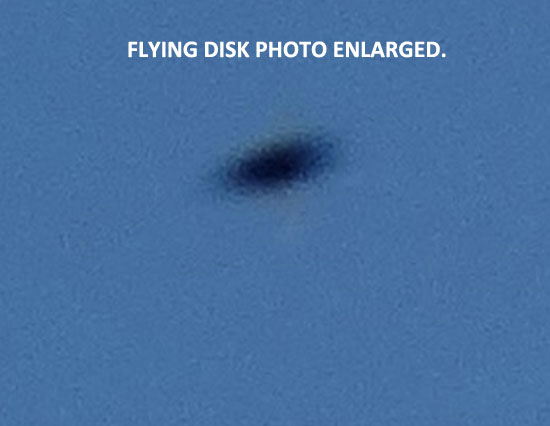 1ST OF 2 PHOTOS TAKEN OF FLYING DISK SEEN IN DAY SKY.