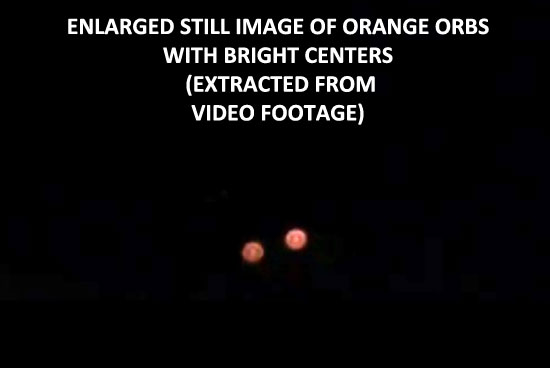 ENLARGED STILL IMAGE OF UNUSUAL ORANGE ORBS. (EXTRACED FROM VIDEO.)