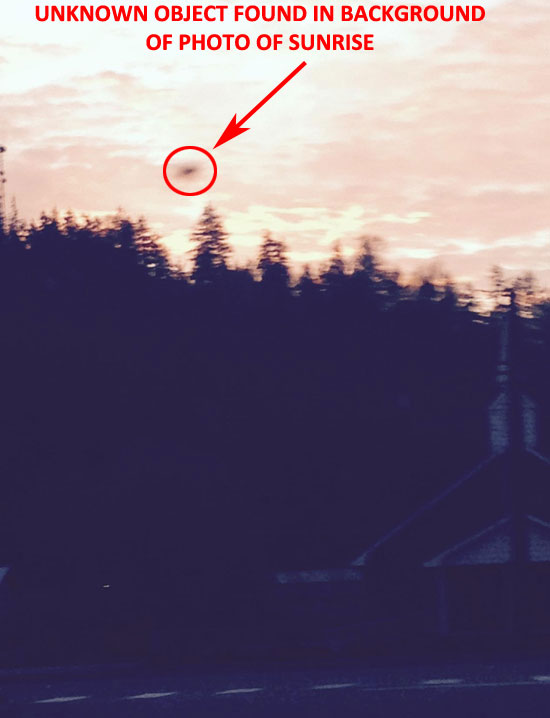 PHOTO OF AERIAL OBJECT FOUND IN PHOTO BACKGROUND.