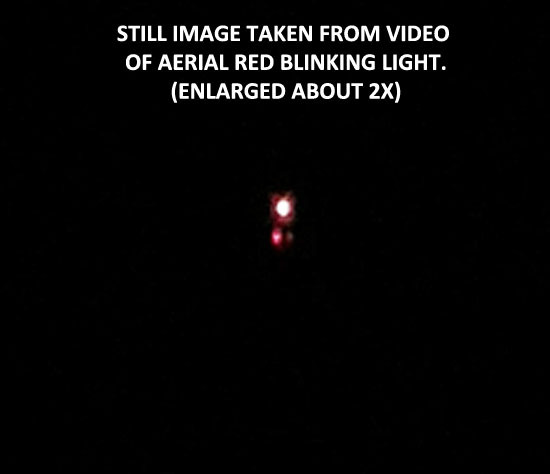 STILL IMAGE TAKEN FROM VIDEO OF RED BLINKING LIGHT.