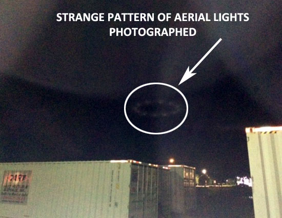 PHOTO OF CIRCULAR PATTERN OF AERIAL LIGHTS.