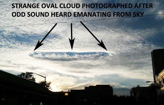 PHOTO OF STRANGE OVAL CLOUD SEEN AFTER LOUD AERIAL SOUND.