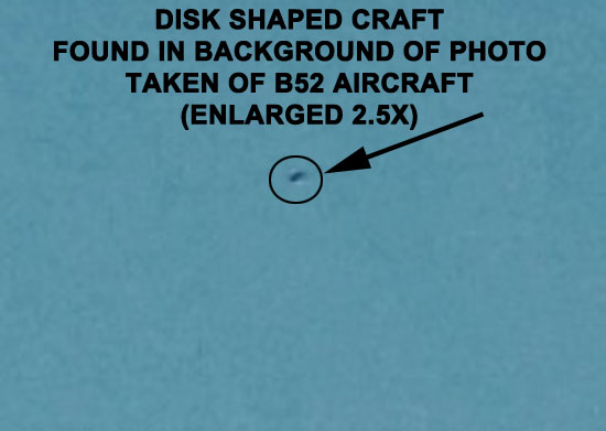 DISK SHAPED CRAFT FOUND IN BACKGROUND OF PHOTO OF B52 AIRCRAFT.