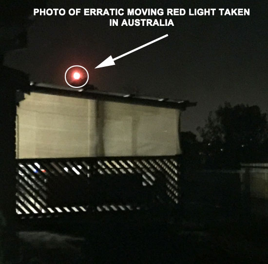PHOTO OF ERRATIC MOVING RED LIGHT.
