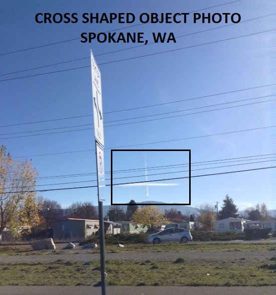 PHOTO OF WHITE CROSS SHAPED OBJECT.