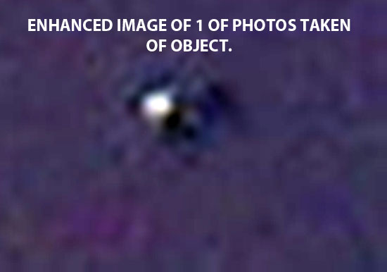 1 OF ENHANCED PHOTOS TAKEN OF OBJECT. (ENLARGED)