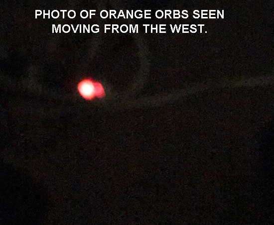 PHOTO OF ORANGE ORBS SEEN MOVING FROM THE WEST.