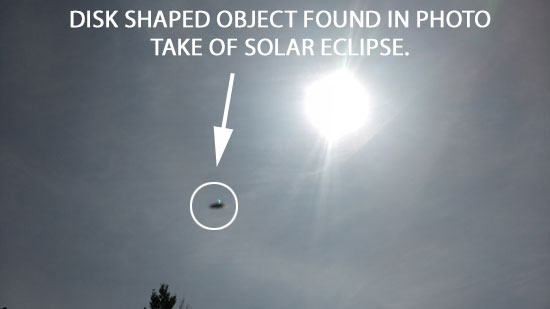 PHOTO OF START OF ECLIPSE SHOWING DISK SHAPED OBJECT.