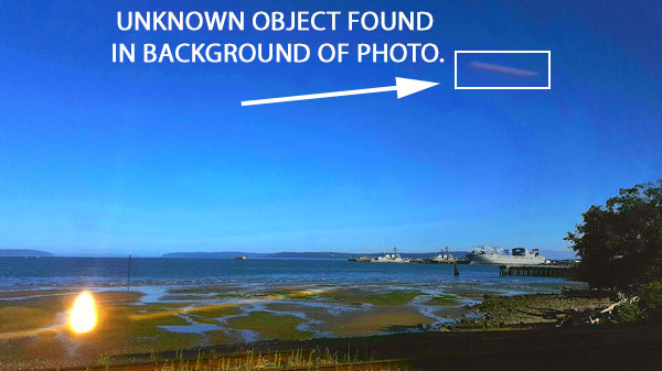 UNKNOWN RECTANGULAR OBJECT FOUND IN BACKGROUND OF PHOTO.