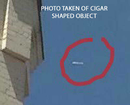 PHOTO OF WHITE CIGAR SHAPED OBJECT.