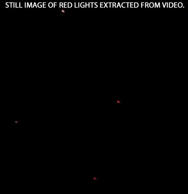 STILL IMAGE OF RED LIGHTS IN DIAMOND FORMATION EXTRACTED FROM VIDEO.