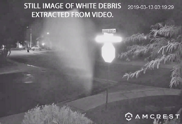 STILL IMAGE OF WHITE DEBRIS EXTRACTED FROM VIDEO.
