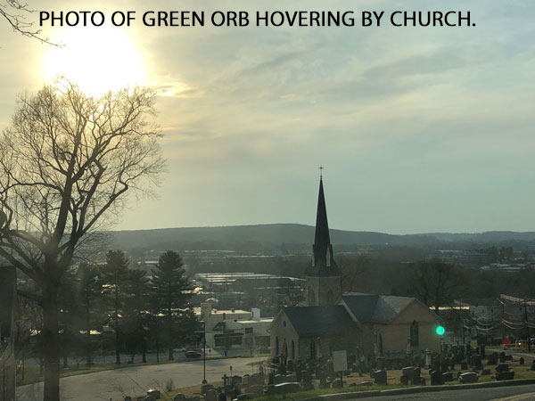 PHOTO OF GREEN ORB HOVERING BY CHURCH.