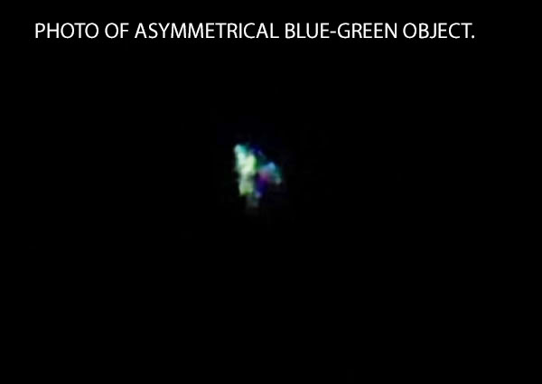 PHOTO OF ASYMMETRICAL BLUE-GREEN OBJECT.