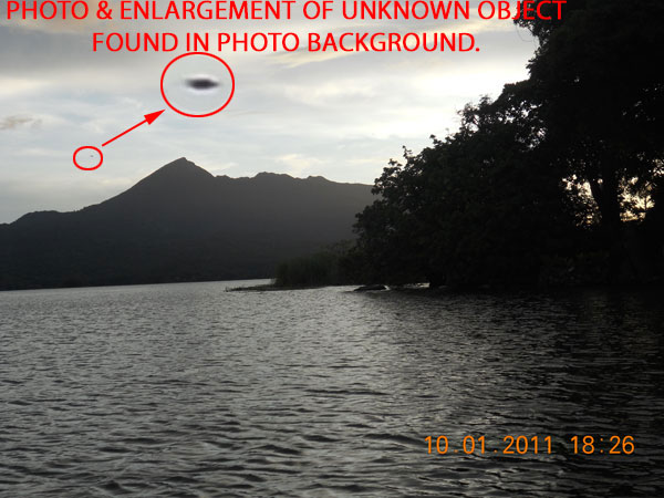 PHOTO & ENLARGEMENT OF UNKNOWN OBJECT FOUND IN PHOTO BACKGROUND.