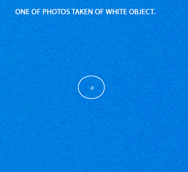 ONE OF PHOTOS TAKEN OF WHITE OBJECT.