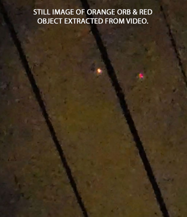 STILL IMAGE OF ORANGE ORB & RED OBJECT EXTRACTED FROM VIDEO.