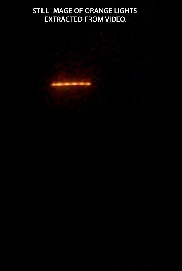 STILL IMAGE OF ORANGE LIGHTS EXTRACTED FROM VIDEO.