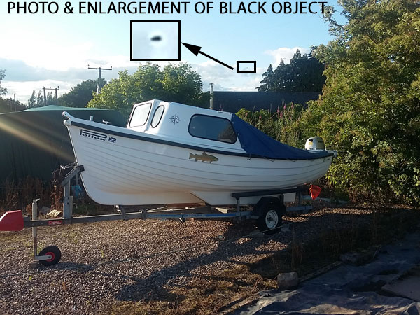 PHOTO & ENLARGEMENT OF UNKNOWN BLACK OBJECT.