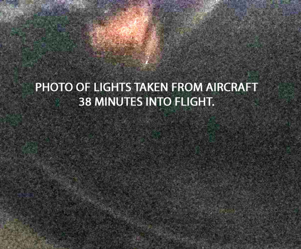 PHOTO OF LIGHTS TAKEN FROM AIRCRAFT 38 MINUTES INTO FLIGHT. (CONTRAST HAS BEEN ENHANCED.)