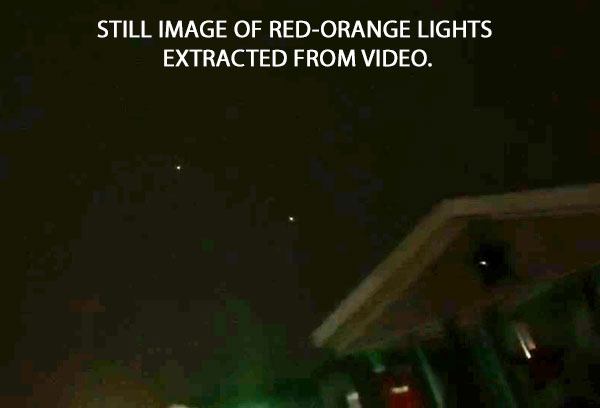 STILL IMAGE OF RED-ORANGE LIGHTS EXTRACTED FROM VIDEO.