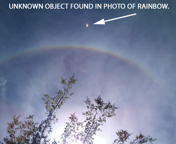 UNKNOWN OBJECT FOUND IN PHOTO OF RAINBOW.