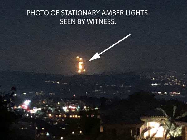 PHOTO OF STATIONARY AMBER LIGHTS SEEN BY WITNESS.