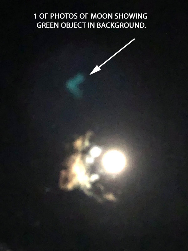 1 OF PHOTOS OF MOON SHOWING GREEN OBJECT IN BACKGROUND.