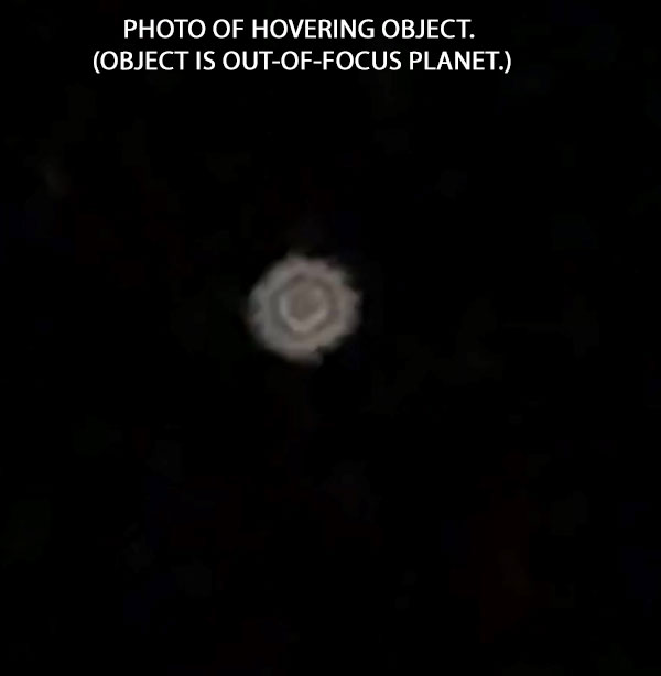 PHOTO OF HOVERING OBJECT. OBJECT IS OUT-OF-FOCUS PLANET.