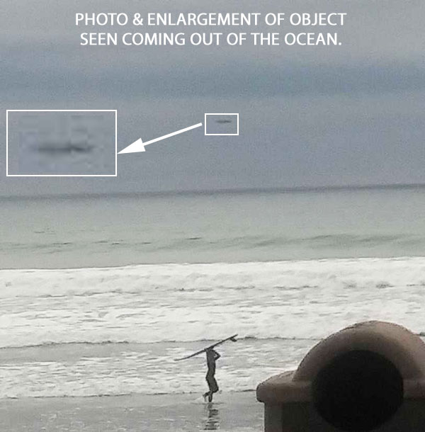 PHOTO & ENLARGEMENT OF OBJECT SEEN COMING OUT OF OCEAN.