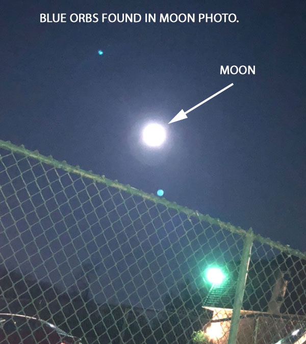 BLUE ORBS FOUND IN PHOTO OF MOON.