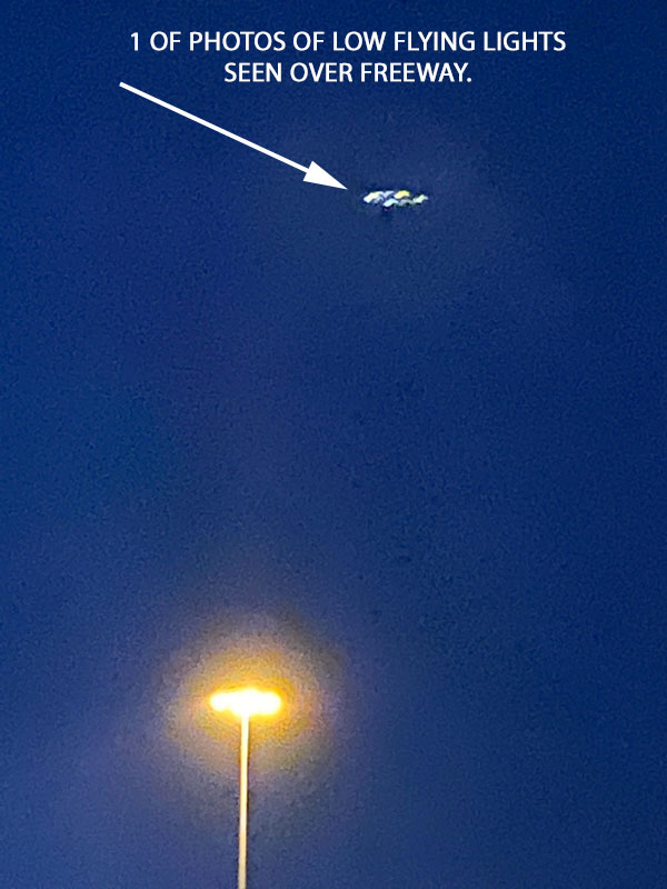 1 OF PHOTOS OF LOW FLYING LIGHTS SEEN OVER FREEWAY.