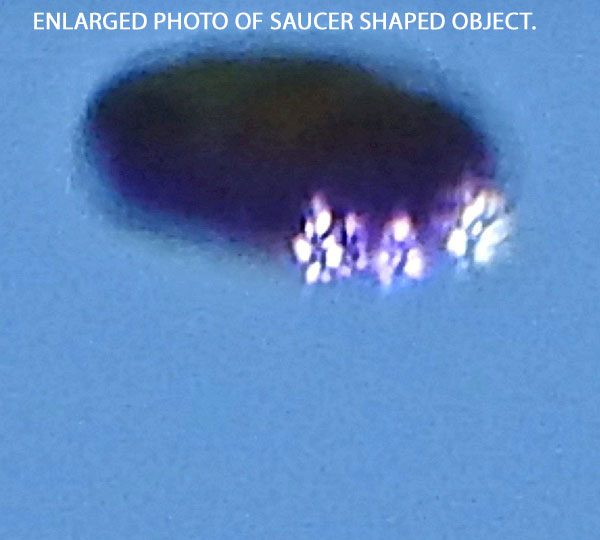 ENLARGED PHOTO OF SAUCER SHAPED OBJECT.