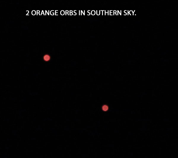 PHOTO OF 2 ORANGE ORBS IN SOUTHERN SKY.