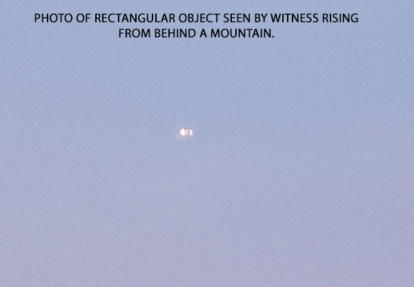 PHOTO OF RECTANGULAR OBJECT SEEN BY WITNESS RISING FROM BEHIND MOUNTAIN.