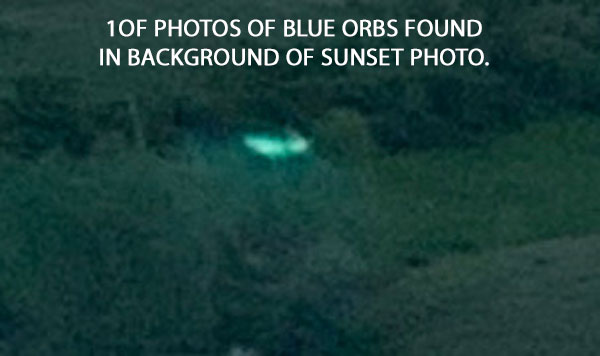 1 OF PHOTOS OF BLUE ORBS FOUND IN BACKGROUND OF PHOTO OF SUNSET.