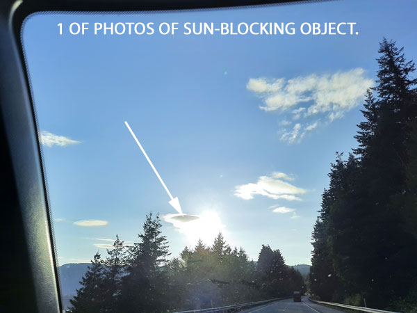 1 OF PHOTOS OF SUN-BLOCKING OBJECT.