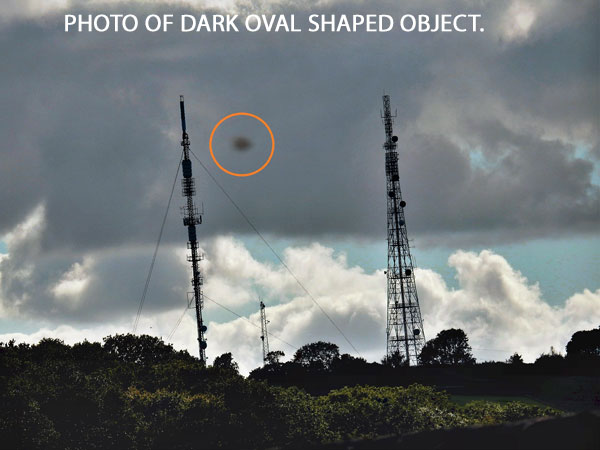 PHOTO OF DARK OVAL SHAPED OBJECT SEEN BY WITNESS.