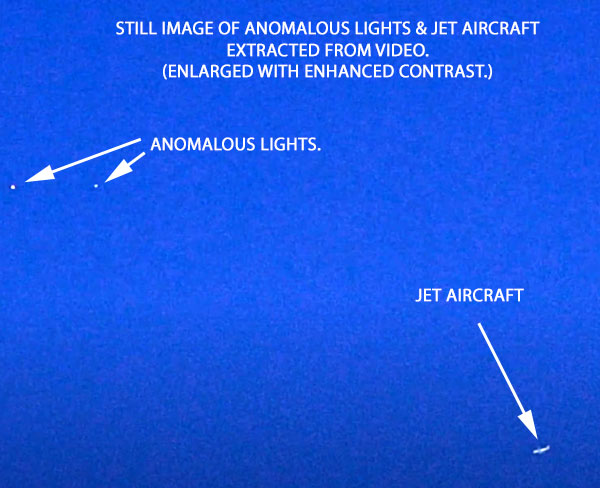 ENHANCED STILL IMAGE OF BALLS OF LIGHT & JETLINER EXTRACTED FROM VIDEO.