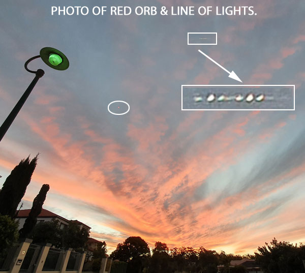 PHOTO OF RED ORB & LINE OF LIGHTS.